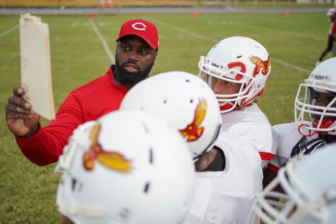 Seneca High School offensive coordinator DaMarcus Smith interacts players prior to the football game played against Shawnee High School in Louisville, Ky., Saturday, September 6, 2019.