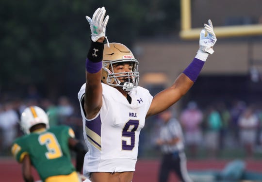 Male's Briceson Rodgers (9) motioned towards the fans after he scored a touchdown on a long bomb against St. X during their game at St. X.   Sept. 6, 2019