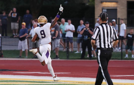 Male's Briceson Rodgers (9) scores a touchdown on a long bomb against St. X during their game at St. X.   Sept. 6, 2019