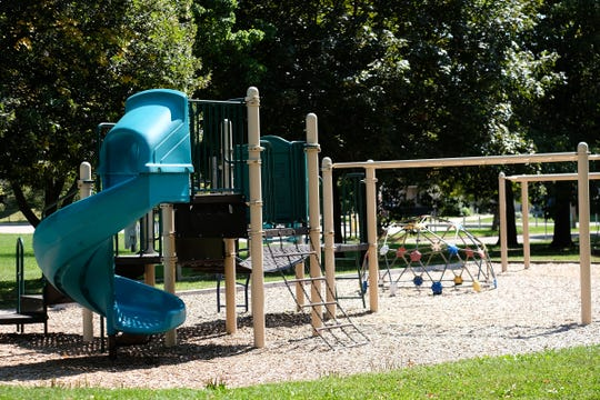 The graffiti has been removed from the playground equipment at Lansing's Ferris Park Saturday, Sept. 7, 2019.