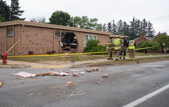 A truck crashed into this building at the corner of Cloverland Drive and S. Cedar Street Friday evening, Sept. 6, 2019.  Eyewitnesses said the driver then drove backward south on Cedar St. hitting an SUV and then smashing through a vacant Family Dollar at the corner of South Cedar St. and Jolly Road. The incident is under investigation.