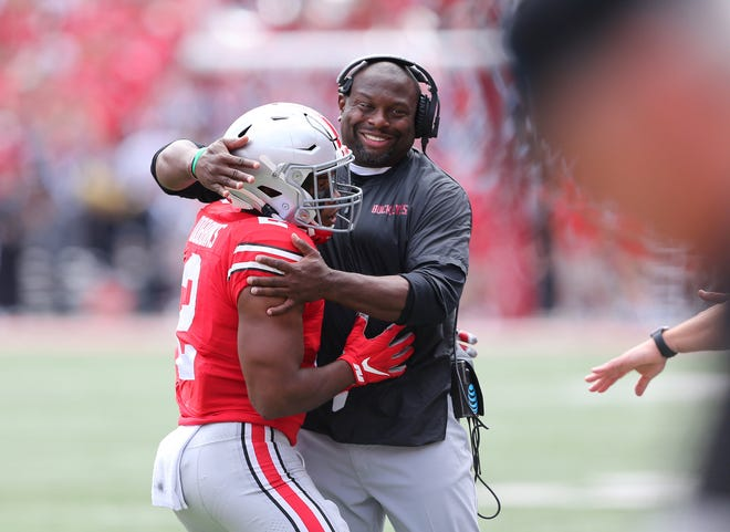 J.K. Dobbins celebrates his 60-yard touchdown run with Ohio State running backs coach Tony Alford.