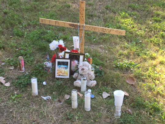 A shrine to Tray Smith sits by the alley where the teen was shot and killed on Aug. 31.