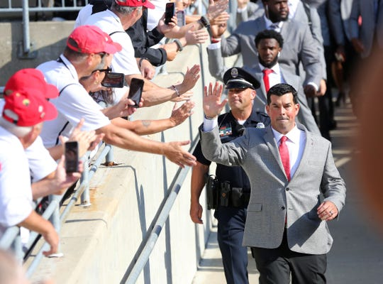 Ohio State coach Ryan Day and the Buckeyes greet fans as they walk into Ohio Stadium before Saturday's 42-0 win over Cincinnati.