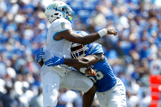 Memphis defensive end Bryce Huff hits Southern quarterback Ladarius Skelton after he releases the ball during their game at the Liberty Bowl Memorial Stadium on Saturday, Sept. 7, 2019.