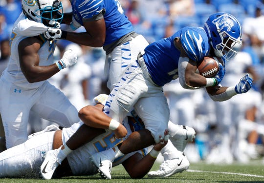 Memphis running back Kenneth Gainwell leans forward for extra yards on a run against Southern during their game at the Liberty Bowl Memorial Stadium on Saturday, Sept. 7, 2019.