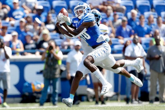 Memphis wide receiver Damonte Coxie tries to catch the ball against Southern defender O.J. Tucker during their game at the Liberty Bowl Memorial Stadium on Saturday, Sept. 7, 2019.