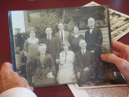 A family photo of Esther, seated center, with her parents, Paul, standing far right,  and Ethyl, seated left.