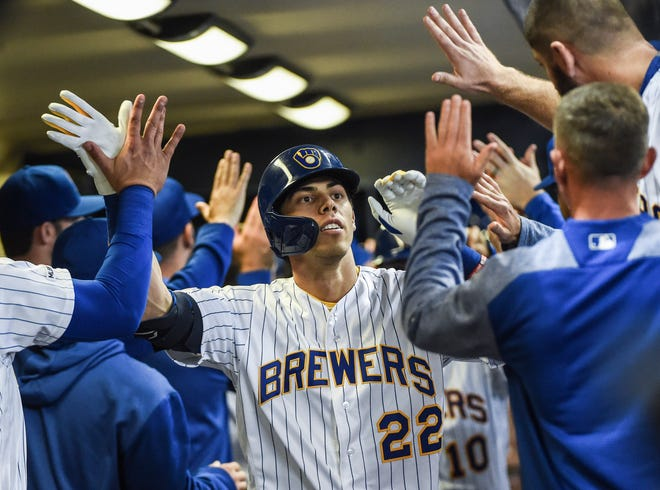 The Brewers' Christian Yelich celebrates in the dugout after hitting a  homer last season.