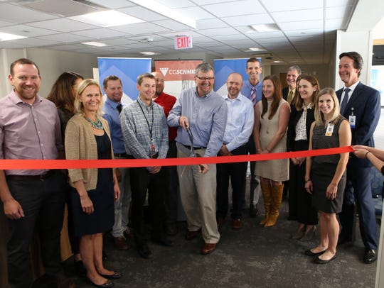 Dr. Kim Merriman cuts the ribbon of the new Ascension Columbia St. Mary's Clinic in the former Shorewood Sendik's building. Merriman has been in Shorewood since 1982, when Shorewood Family Physicians first opened. Merriman is joined by village officials, C.G. Schmidt employees and Ascension Medical Group providers.