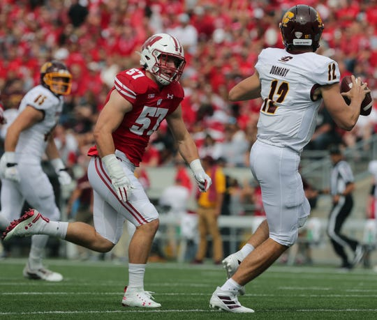 Wisconsin linebacker Jack Sanborn (57) pressures Central Michigan quarterback Quinten Dormady.