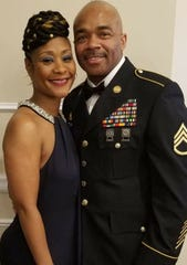 Tracey Smith poses for a photo with her boyfriend, Marcus Jemison. Smith, a sergeant with the Wisconsin Department of Corrections, died Aug. 30 after prosecutors say a man shot her following a minor crash. Jemison is a sergeant in the U.S. Army and also a corrections officer.
