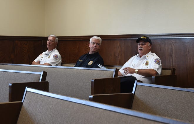 Mountain Home Fire Chief Ken Williams (right) answers a question from the City Council while Police Chief Carry Manuel (center) and Fire Marshal Gary Pyszka (left) listen Thursday evening.