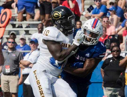 Grambling State's Lyndon Rash (10) collides with Louisiana Tech's Darryl Lewis (4) during the game at Joe Aillet Stadium in Ruston, La. on Sept. 7.