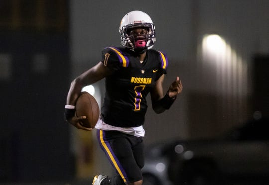 Wossman quarterback Antrell Green carries the ball in a  48-12 win over Booker T. Washington at Grady Jones Memorial Stadium on Friday night.