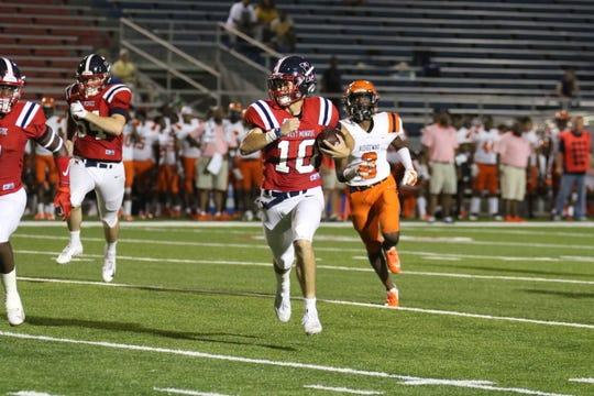 West Monroe junior quarterback Lane Little (10) runs the ball against Ridgeway High School Friday, Sept. 6 at Rebel Stadium.