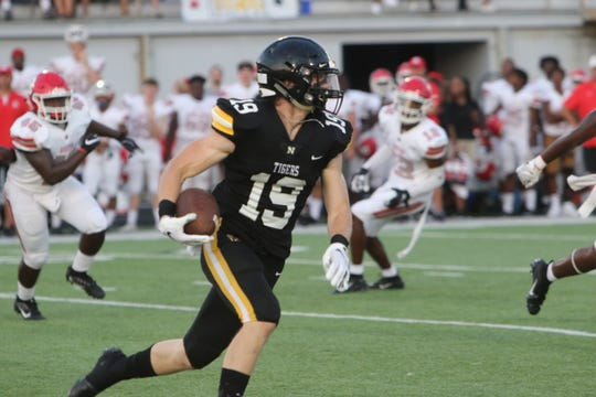 Zeb Ruddell (19) returned an interception 55 yards for the go-ahead touchdown in Neville's 19-14 win over Bastrop last Friday night at Bill Ruple Stadium.