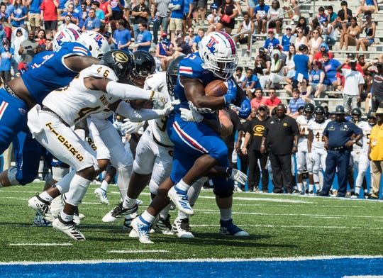 Louisiana Tech's Justin Henderson (33) carries the ball the three yards needed to open up the scoring during the game against Grambling State at Joe Aillet Stadium in Ruston, La. on Sept. 7.