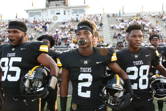 The Neville Tigers face the defending Division III state champion University Lab Cubs on Friday night at Bill Ruple Stadium.