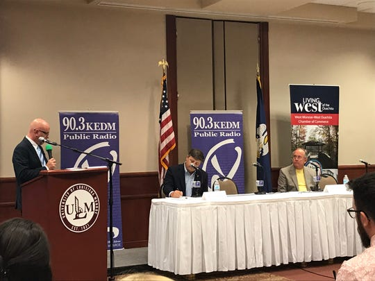 Forum moderator Cory Crowe addresses 33rd Senate District candidates Stewart Cathey Jr., R-Sterlington and Wade Bishop, R-West Monroe.