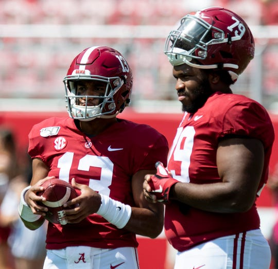 Alabama quarterback Tua Tagovailoa (13) talks with Alabama offensive lineman Chris Owens (79) before the New Mexico State game at Bryant-Denny Stadium in Tuscaloosa, Ala., on Saturday September 7, 2019.
