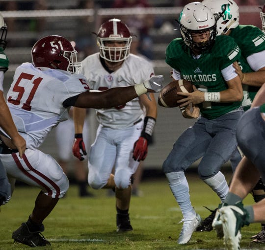 Handley's Gregory Joiner (51) strips the ball from Holtville's Braxton Buck (4), Buck recovered the ball, at Holtville High School in Deatsville, Ala., on Friday, Sept. 6, 2019. Handley defeated Holtville 34-6.