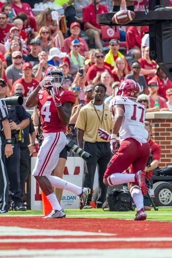 Alabama wide receiver Jerry Jeudy (4) grabs a touchdown reception as New Mexico State defensive back Jason Simmons Jr. (17) trails during the first half of an NCAA college football game Saturday, Sept. 7, 2019, in Tuscaloosa, Ala. (AP Photo/Vasha Hunt)