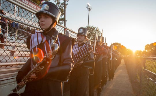 The Alabama Christian Academy band marches into the stadium.
