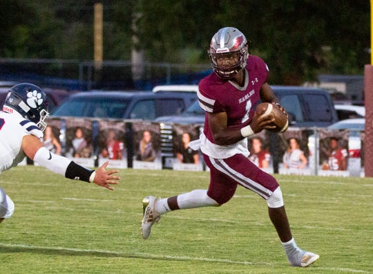 ACA's Jalen Clark keeps his eyes up as he runs the ball against Trinity on Sept. 6.
