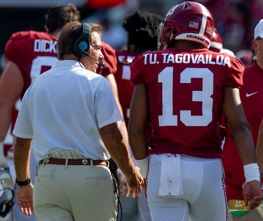Alabama head coach Nick Saban  talks with Alabama quarterback Tua Tagovailoa (13) during the New Mexico State game at Bryant-Denny Stadium in Tuscaloosa, Ala., on Saturday September 7, 2019.