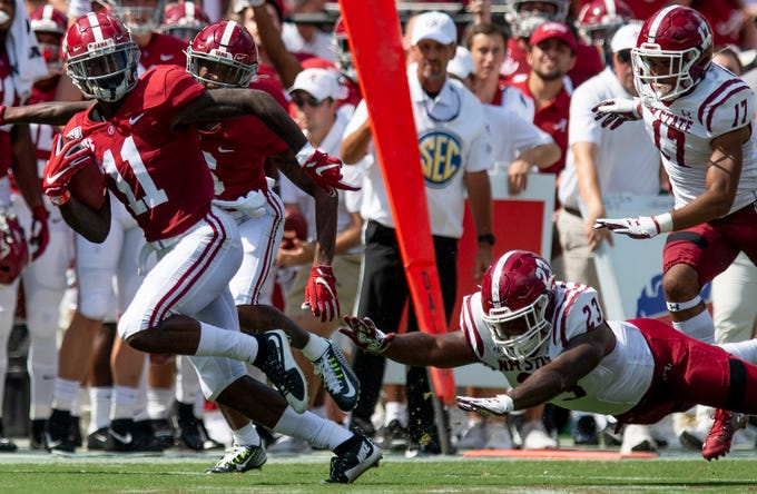 Alabama wide receiver Henry Ruggs, III, (11) gets by New Mexico State linebacker Rashie Hodge, Jr., (23) on a long touchdown to open the game for Alabama at Bryant-Denny Stadium in Tuscaloosa, Ala., on Saturday September 7, 2019.