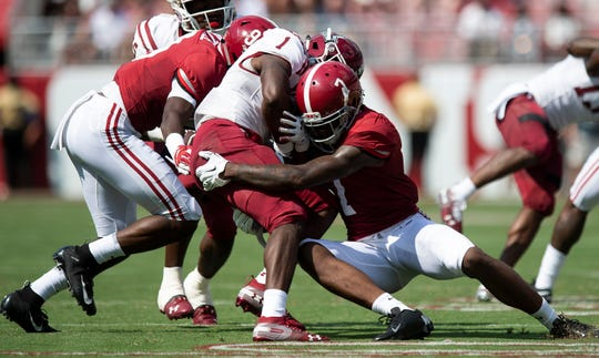 Alabama defensive back Trevon Diggs (7) stops New Mexico State running back Jason Huntley (1) at Bryant-Denny Stadium in Tuscaloosa, Ala., on Saturday September 7, 2019.