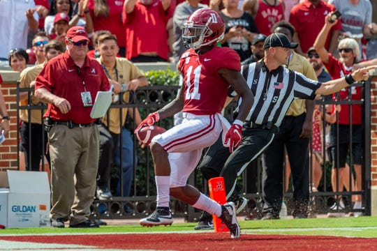 Alabama wide receiver Henry Ruggs III (11) scores the first touchdown, a pass reception, on the first play from scrimmage against New Mexico State during the first half of an NCAA college football game Saturday, Sept. 7, 2019, in Tuscaloosa, Ala. (AP Photo/Vasha Hunt)