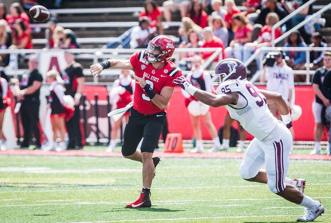 Ball State's Drew Plitt passes against Fordham's defense during their game at Scheumann Stadium Saturday, Sept. 7, 2019.