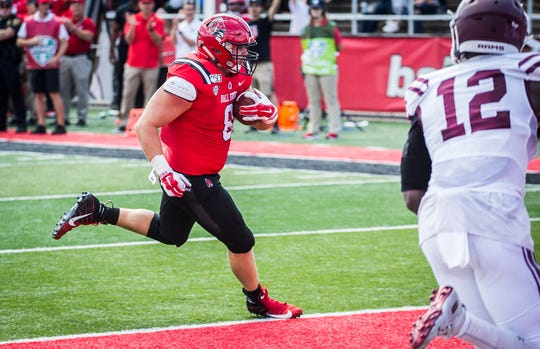 Ball State's Cody Rudy crosses the goal line for a touchdown against Fordham's during their game at Scheumann Stadium Saturday, Sept. 7, 2019.