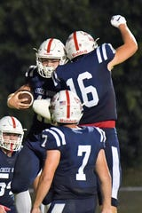 Creek Wood's Danny Stansberry (11) celebrates scoring a touchdown against Greenbrier with teammate Sam Batey (16) during the first half at Creek Wood High School in Charlotte, Tenn., Friday, Sept. 6, 2019.
