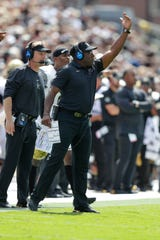 Vanderbilt head coach Derek Mason signals from the sidelines during the first half of an NCAA college football game against Purdue in West Lafayette, Ind., Saturday, Sept. 7, 2019.