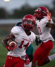 Immokalee's Charles Toombs carries the ball against Gulf Coast, Friday, Sept. 6, 2019 at Gulf Coast High School.