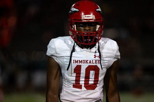 Immokalee High School's Pierre Percial heads back to the sideline after a play against Gulf Coast, Friday, Sept. 6, 2019 at Gulf Coast High School.