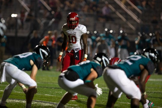 Immokalee High School's Pierre Percial lines up on defense against Gulf Coast, Friday, Sept. 6, 2019 at Gulf Coast High School.