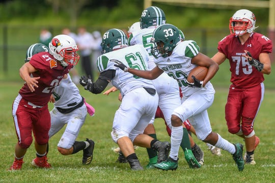 New Milford football at Pompton Lakes on Saturday, September 7, 2019. NM #33 Donald Coaxum III.
