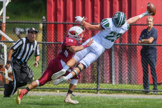 New Milford football at Pompton Lakes on Saturday, September 7, 2019. NM #23 Tyler Picinic reaches for a pass in the first quarter as PL #75 Jason Testino defends.