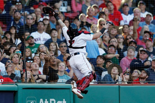 Boston Red Sox's Christian Vazquez makes the catch on a pop foul by New York Yankees' Edwin Encarnacion during the fifth inning of a game in Boston, Saturday, Sept. 7, 2019.