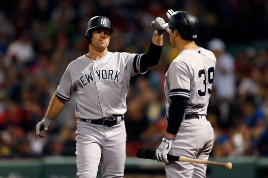 New York Yankees' Brett Gardner celebrates his solo home run with Mike Tauchman (39) during the fifth inning of a baseball game against the Boston Red Sox in Boston, Friday, Sept. 6, 2019.