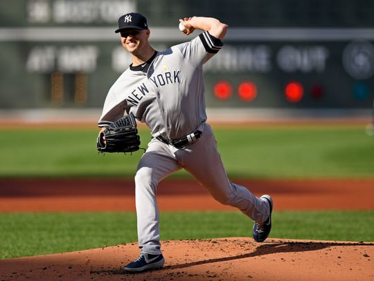 Sep 7, 2019; Boston, MA, USA; New York Yankees starting pitcher J.A. Happ (34) pitches against the Boston Red Sox  during the first inning at Fenway Park.
