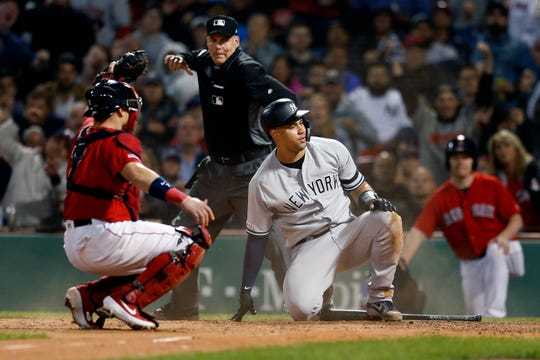 Boston Red Sox's Christian Vazquez, left, holds the ball as New York Yankees' Gary Sanchez is called out trying to score on a single by Brett Gardner during the seventh inning of a game in Boston, Friday, Sept. 6, 2019.