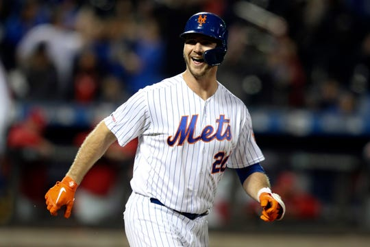 New York Mets' Pete Alonso reacts after being walked with the bases loaded for the win against the Philadelphia Phillies in the ninth inning of their game Friday, Sept. 6, 2019, in New York.