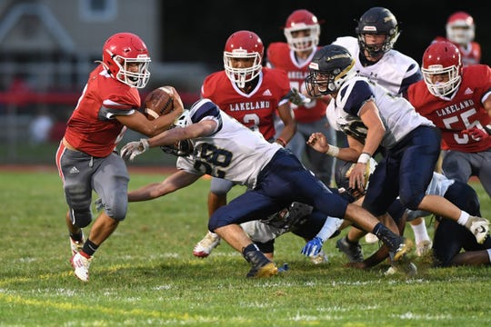 Ramsey football at Lakeland on Friday, September 6, 2019 L #2 Joshua Paduani avoids a tackle.
