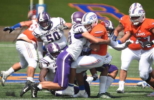 HS football Lodi (orange) vs Garfield (purple)Garfield #10 Maxwell Drakeford tackles Lodi #2 Jason Nunez