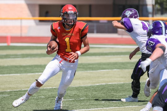 Senior quarterback Adrian Trujillo (1) runs the ball as the Centennial Hawks face off against the Manzano Monarchs from Albuquerque at the Field of Dreams in Las Cruces on Saturday, Sept. 7, 2019.